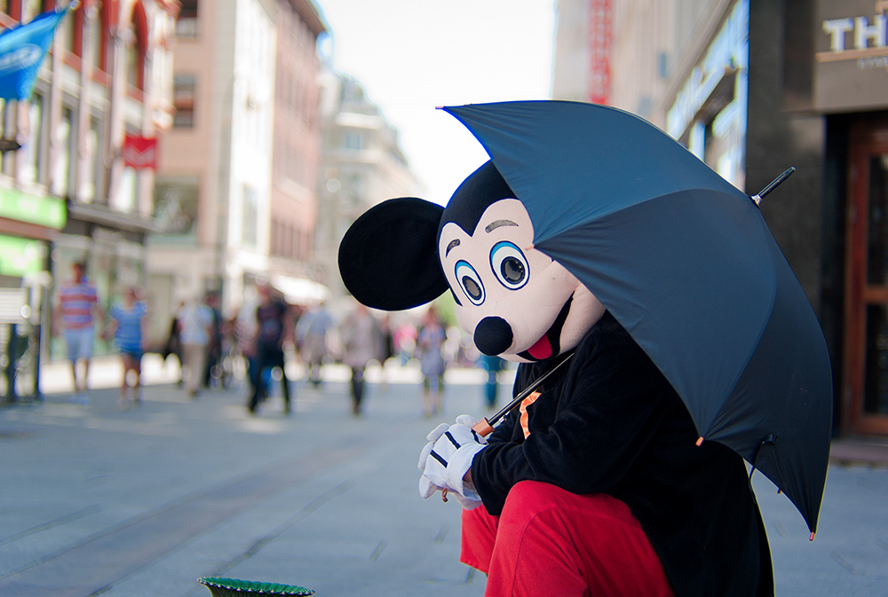 Norway's capital's colorful face can welcome you in any corner. Here is an extra ordinary beggar disguised as mickey mouse | Photo: H.K. Nilsen